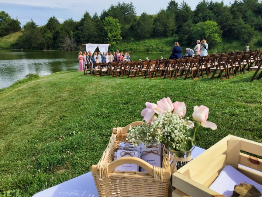 chairs setup by a lake for a wedding
